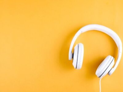 white headphones on yellow background