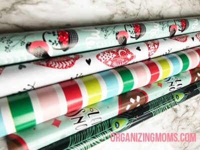 A close up of rolls of Christmas wrapping paper.