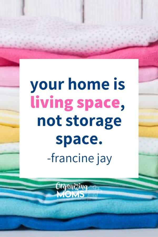 Text - your home is living space, not storage space - francine jay. Close up image of folded clothes in background.